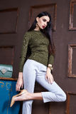 Sexy brunette businesswoman beautiful woman wear stylish. Clothes for lady catalog of fashion in interior room accessory organic wool sweater silk pants perfect Royalty Free Stock Photos