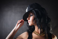 Brunette in cap. Swag girl. Fashion. Portrait of brunette in cap stock image