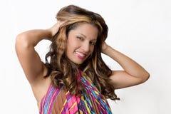 Sexy brunette die haar haar strijken Stock Foto