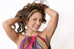 Sexy brunette die haar haar strijken Stock Fotografie