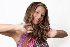 Sexy brunette die haar haar strijken Royalty-vrije Stock Foto