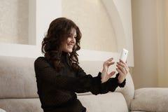 Sexy brunette doing selfie in hotel room Stock Images