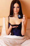 Sexy brunette drinking coffee Stock Photo