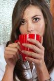 Sexy brunette eating breakfast Stock Photo