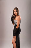 Sexy brunette in evening dress revealing her leg Stock Photography