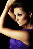 Sexy brunette fashion girl in violet dress Royalty Free Stock Photos