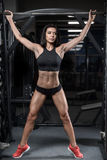 Sexy brunette fitness wet woman after workout in the gym Royalty Free Stock Photos