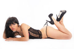 Sexy brunette on the floor Stock Photography