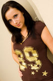 Sexy brunette football fan Stock Photo