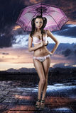 Sexy brunette in full length with open umbrella Stock Photography