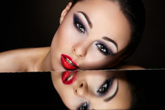brunette girl with bright makeup and red lips Royalty Free Stock Images