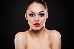 brunette girl with bright makeup and red lips Royalty Free Stock Image