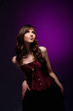 Sexy brunette girl with burgundy corset Stock Photos