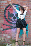 Sexy brunette girl posing, grafittis on the wall Royalty Free Stock Images