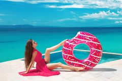 brunette Girl relaxing with inflatable float ring by the ho stock images