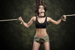 Sexy brunette girl tied by rope Royalty Free Stock Image