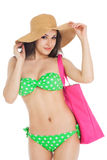 Sexy brunette girl wearing green swimsuit and big hat Royalty Free Stock Photos