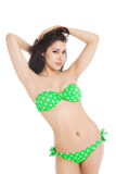 Sexy brunette girl wearing green swimsuit Royalty Free Stock Image