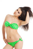 Sexy brunette girl wearing green swimsuit Royalty Free Stock Photography