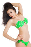 Sexy brunette girl wearing green swimsuit Stock Photography