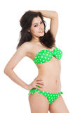 Sexy brunette girl wearing green swimsuit Royalty Free Stock Images