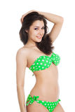 Sexy brunette girl wearing green swimsuit Stock Photo