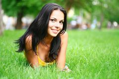 Sexy brunette on grass Stock Photos