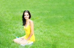 Sexy brunette on grass Royalty Free Stock Photos