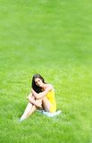 Sexy brunette on grass Royalty Free Stock Photo