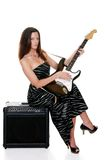 Sexy brunette with a guitar Royalty Free Stock Images
