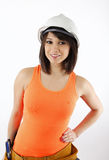 brunette in hard hat and orange tank top Royalty Free Stock Images