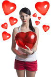 Sexy brunette with heart shaped balloon in front of the camera Stock Photography