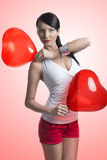brunette with heart shaped balloons on the shoulder Royalty Free Stock Photography