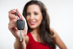 Sexy brunette holding a car key Royalty Free Stock Images