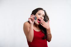 Sexy brunette holding a car key Stock Images