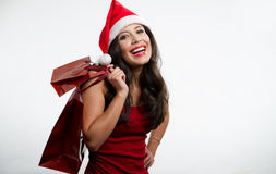 Sexy brunette holding Christmas red shopping bags Royalty Free Stock Images