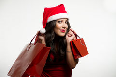 Sexy brunette holding Christmas red shopping bags Stock Photos