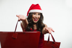 Sexy brunette holding Christmas red shopping bags Stock Image