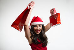 Sexy brunette holding Christmas red shopping bags Stock Images