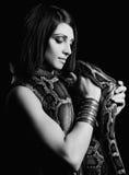 Sexy brunette holding python Stock Image