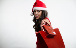 Sexy brunette holding red shopping bags Stock Images