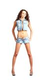 Sexy brunette in jeans wear Royalty Free Stock Photography