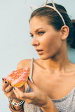 brunette lady eat sweet heart shaped donut. Royalty Free Stock Image