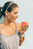 Sexy brunette lady eat sweet heart shaped donut. Stock Images