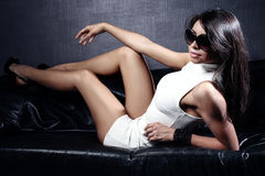 Sexy brunette lady posing in sunglasses. Stock Photos