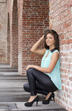Sexy brunette leaning against a wall Stock Photos
