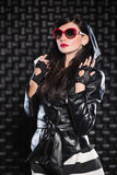 Sexy brunette in leather jacket. With a hood Royalty Free Stock Photo