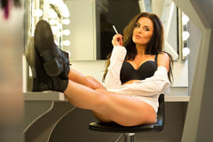Sexy brunette in lingerie and black shoes sitting on the visage' Stock Photo