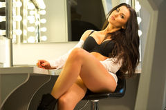 Sexy brunette in lingerie and white shirt sitting on the visage' Royalty Free Stock Photos