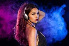 Sexy brunette listening music Royalty Free Stock Photo